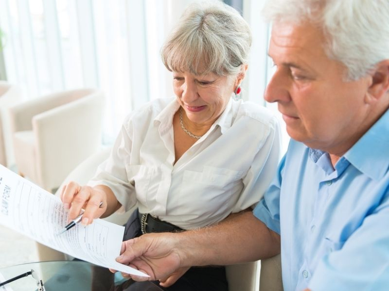 senior couple examining life insurance proposal